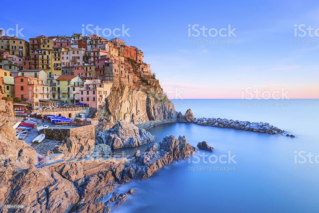 Manarola village, rocks and sea at sunset. Cinque Terre, Italy stock photo