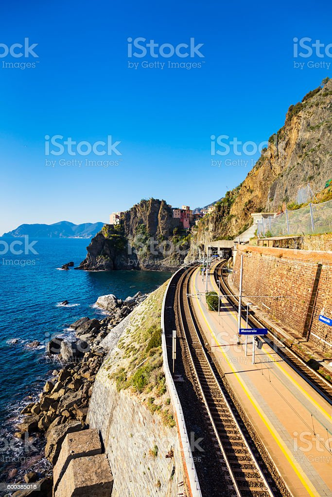 Manarola village, train or railroad station rock and sea. Cinque stock photo