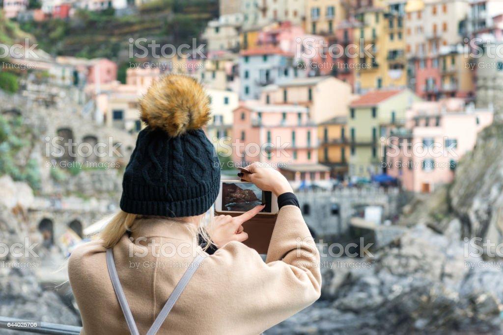 Manarola - woman capturing photo on phone stock photo
