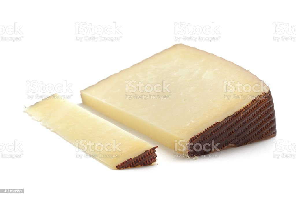 Manchego cheese cut stock photo