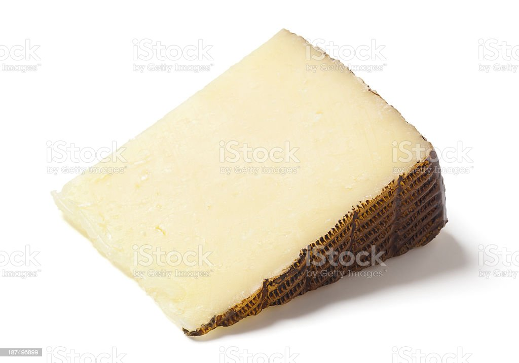 Manchego Cheese Wedge on White Background stock photo