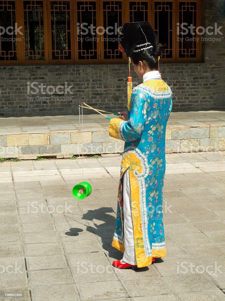 manchurian girl juggling diabolo royalty-free stock photo