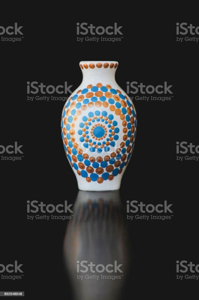 Mandala jug on black background stock photo