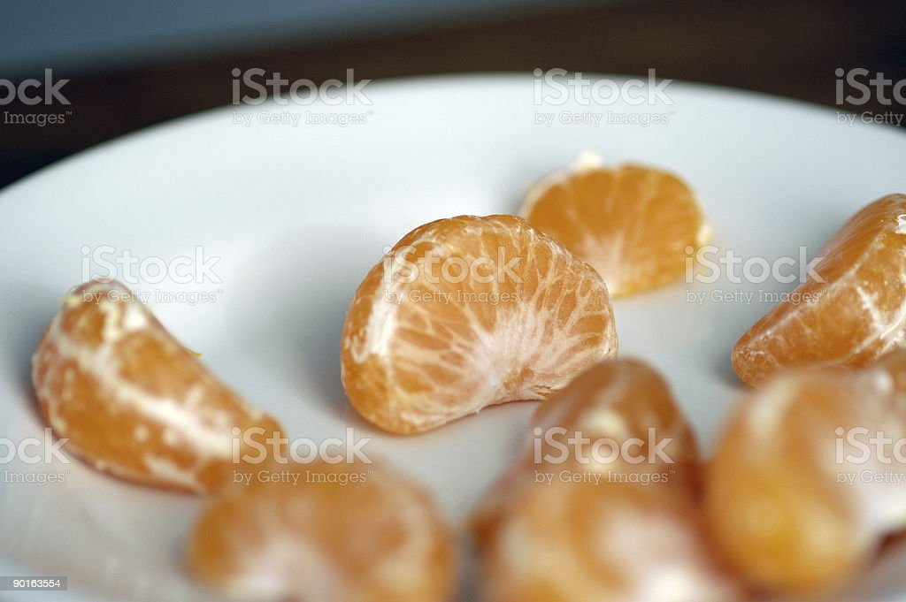 Mandarin orange pieces stock photo