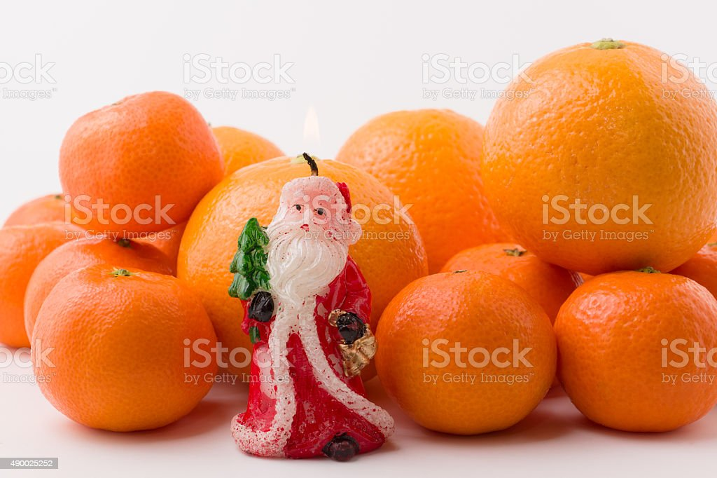 mandarin slide with a candle stock photo