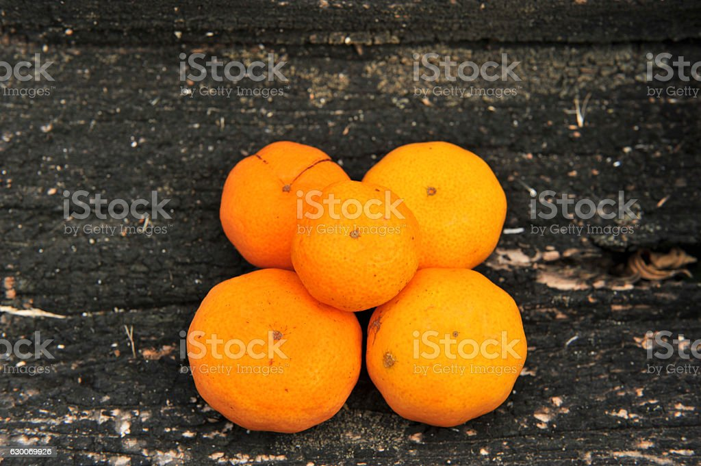 mandarins on the old wooden background stock photo