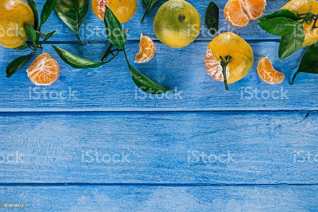 Mandarins over blue stock photo