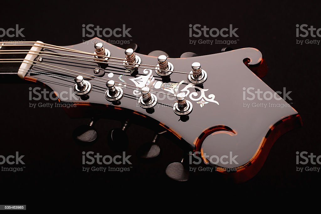 Mandolin detail isolated on black stock photo