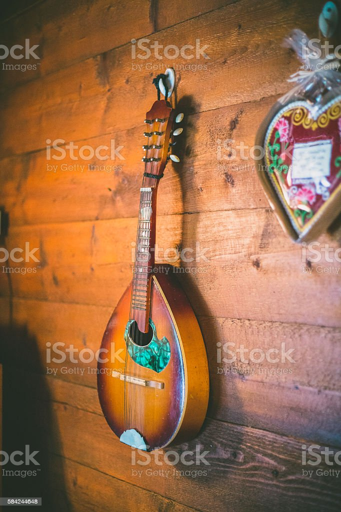 Mandolin Hanging on a Textured Wall stock photo