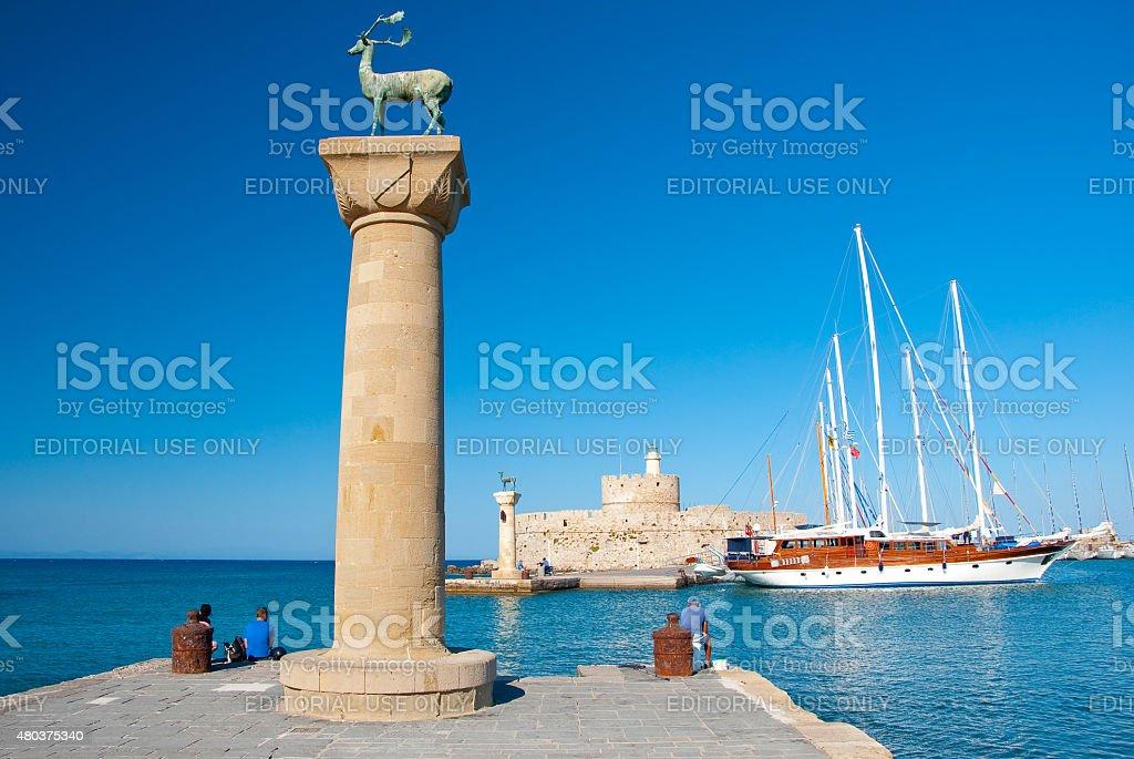 Mandraki harbor with famous bronze deer on Rhodes island, Greece. stock photo