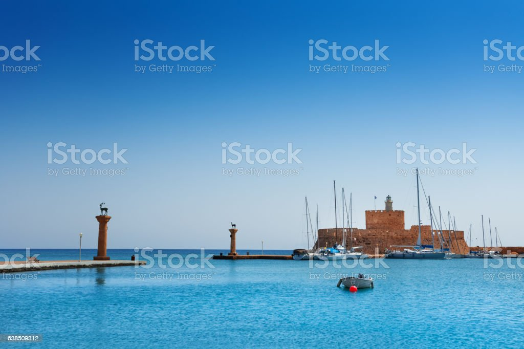 Mandraki Harbor with the fortress of St. Nicholas stock photo