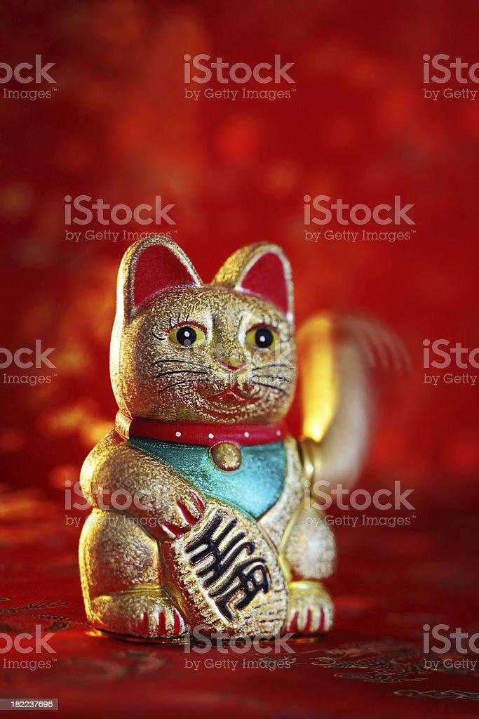 Maneki Neko or Japanese Lucky Cat stock photo