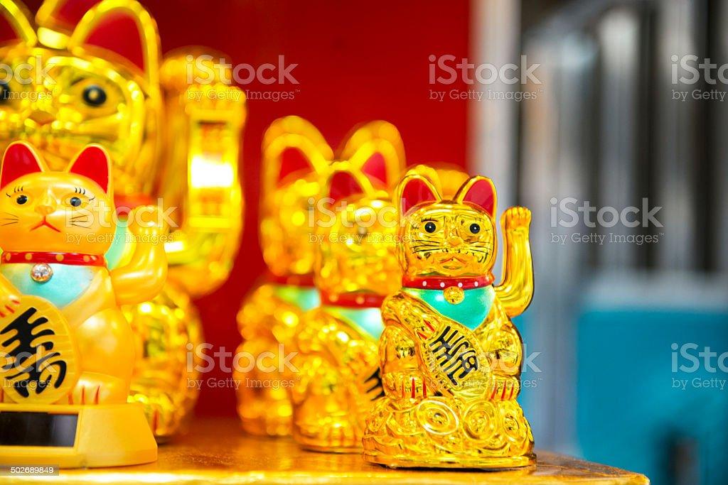 Maneki Neko Waving Lucky Golden Cat in Hong Kong China stock photo