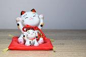 Maneki-neko is a common Japanese figurine (beckoning cat)