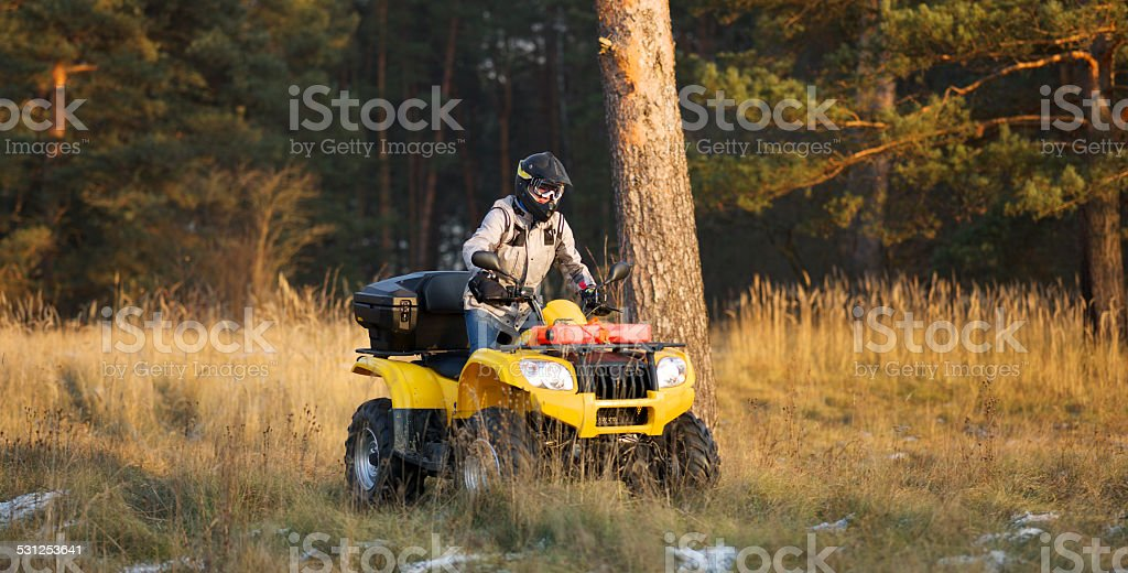 Maneuvering off-road ATV stock photo