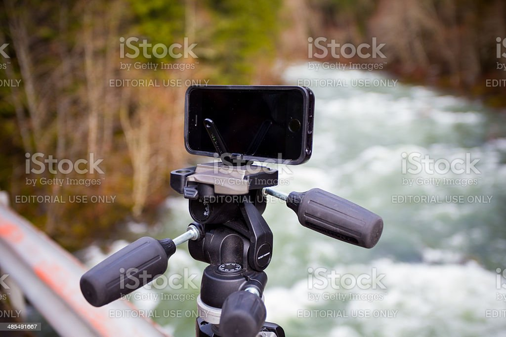 Manfrotto KLYP+ Lens and Tripod System for iPhone stock photo