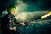 manga styled female superhero with flame thrower