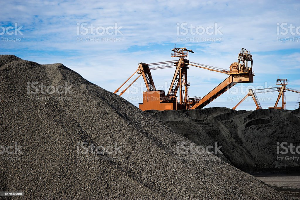 Manganese Ore Stock Pile stacker in background stock photo