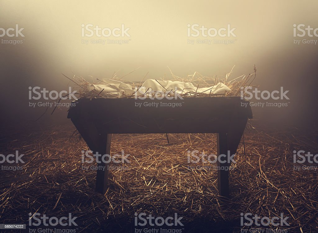 Manger at night under fog stock photo