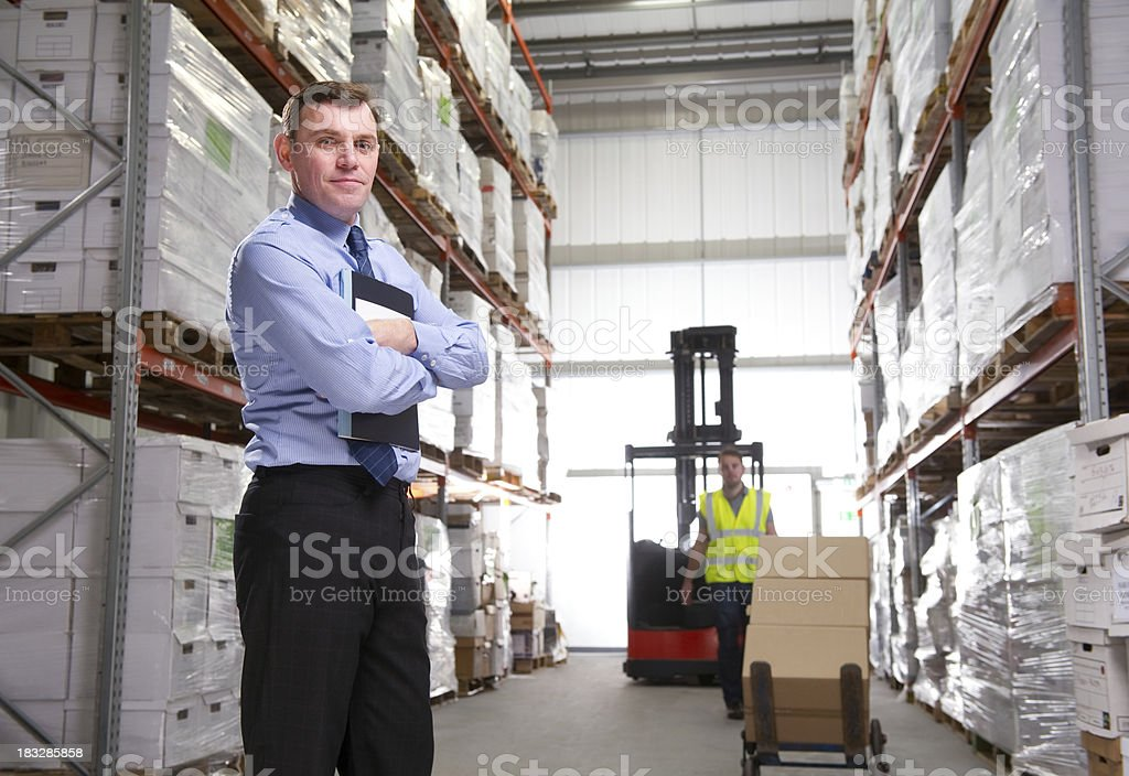 Manger Posing in a Warehouse royalty-free stock photo