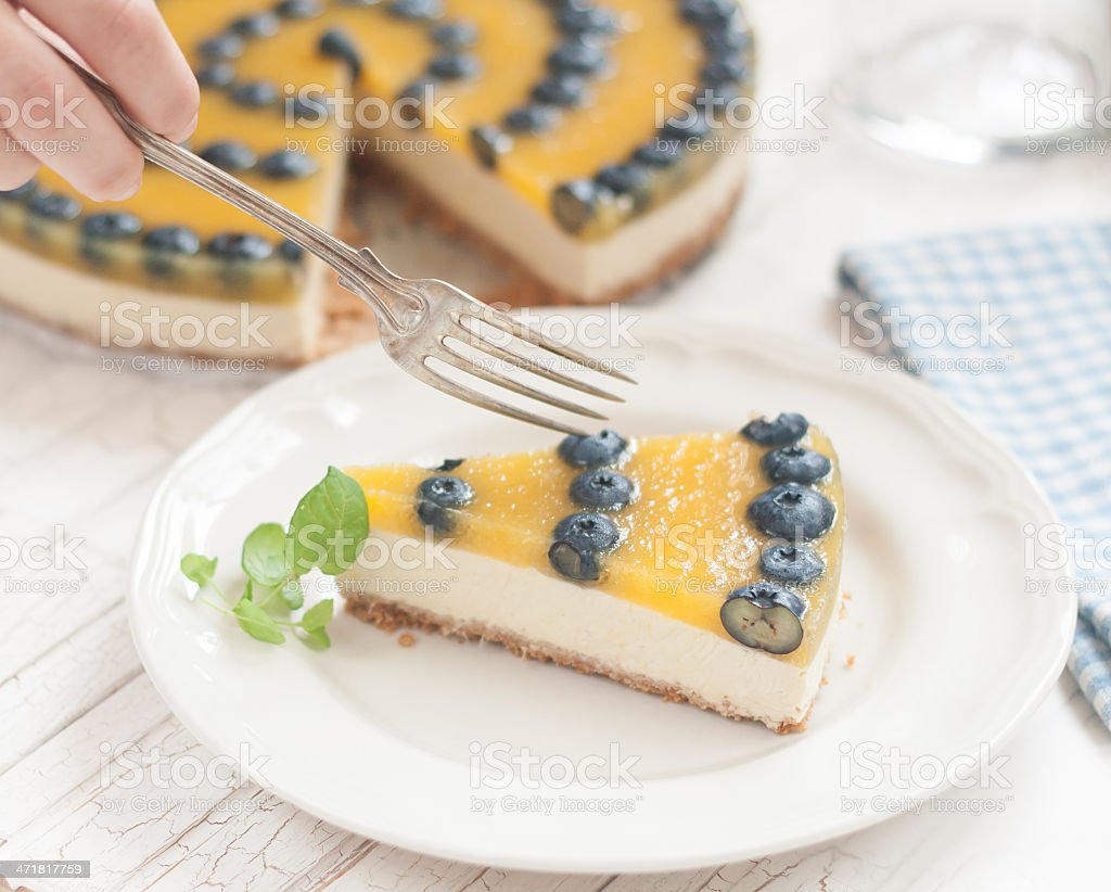 Mango cheesecake with blueberries royalty-free stock photo