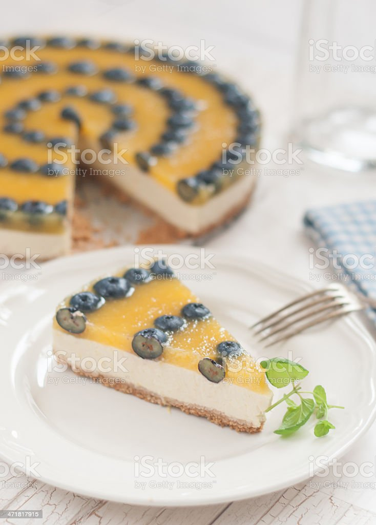 Mango cheesecake with blueberries royalty-free stock photo