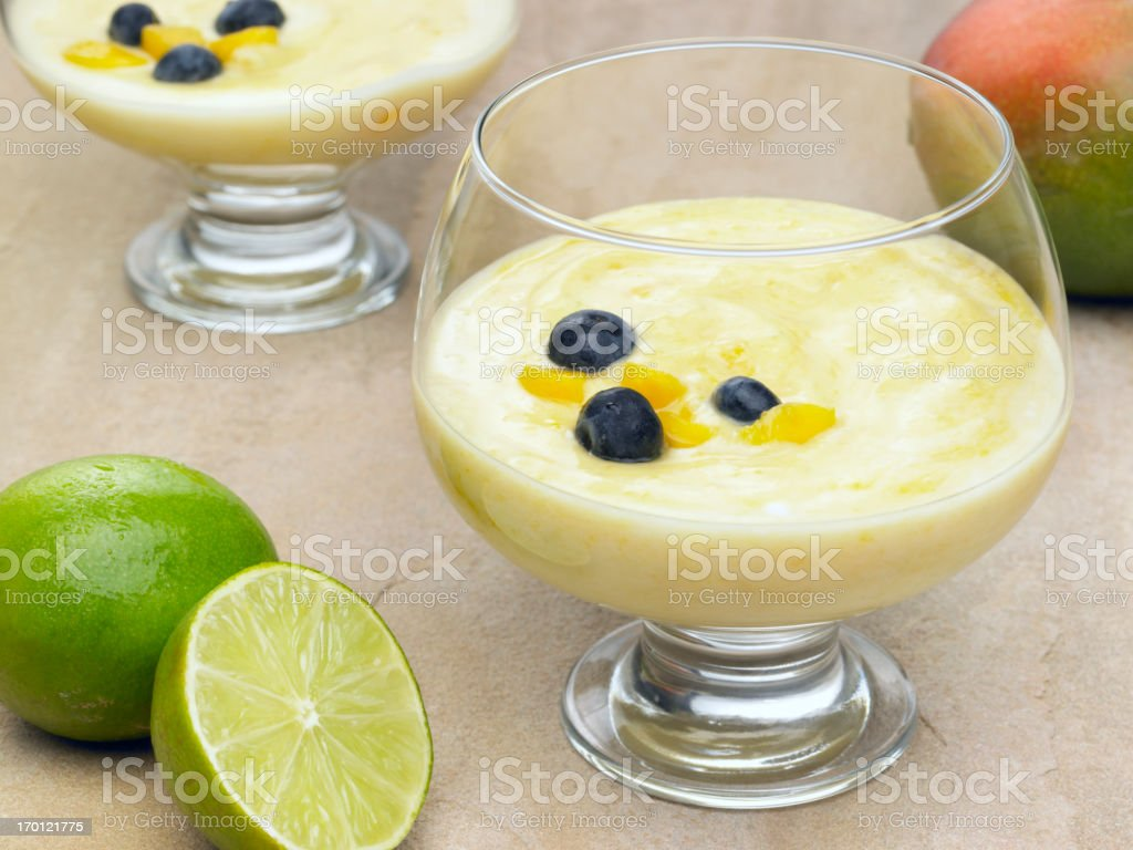 Mango Fool with blueberries royalty-free stock photo
