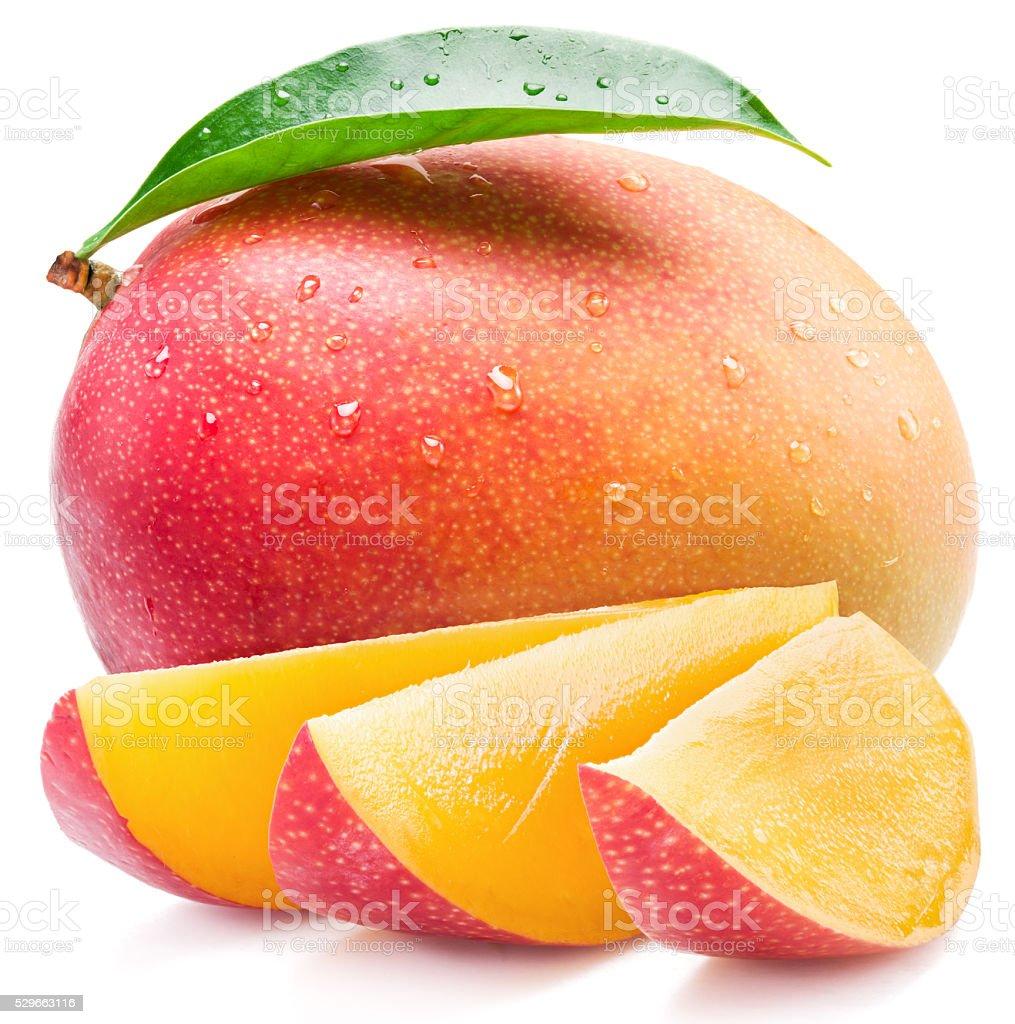 Mango fruit and mango slices. stock photo