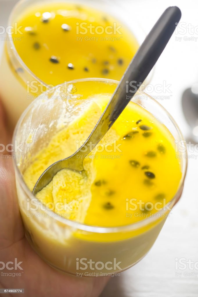 Mango mousse with passionfruit jelly dessert stock photo