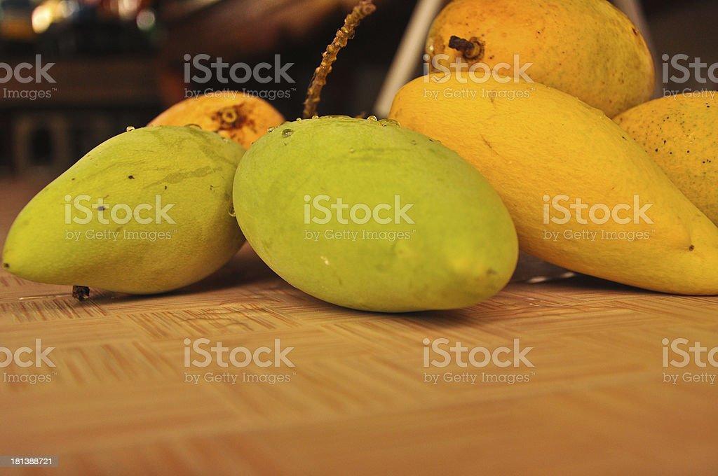 mango, native tropical fruit at open Thailand market,closeup royalty-free stock photo