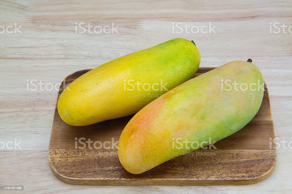 Mango on a wooden background royalty-free stock photo