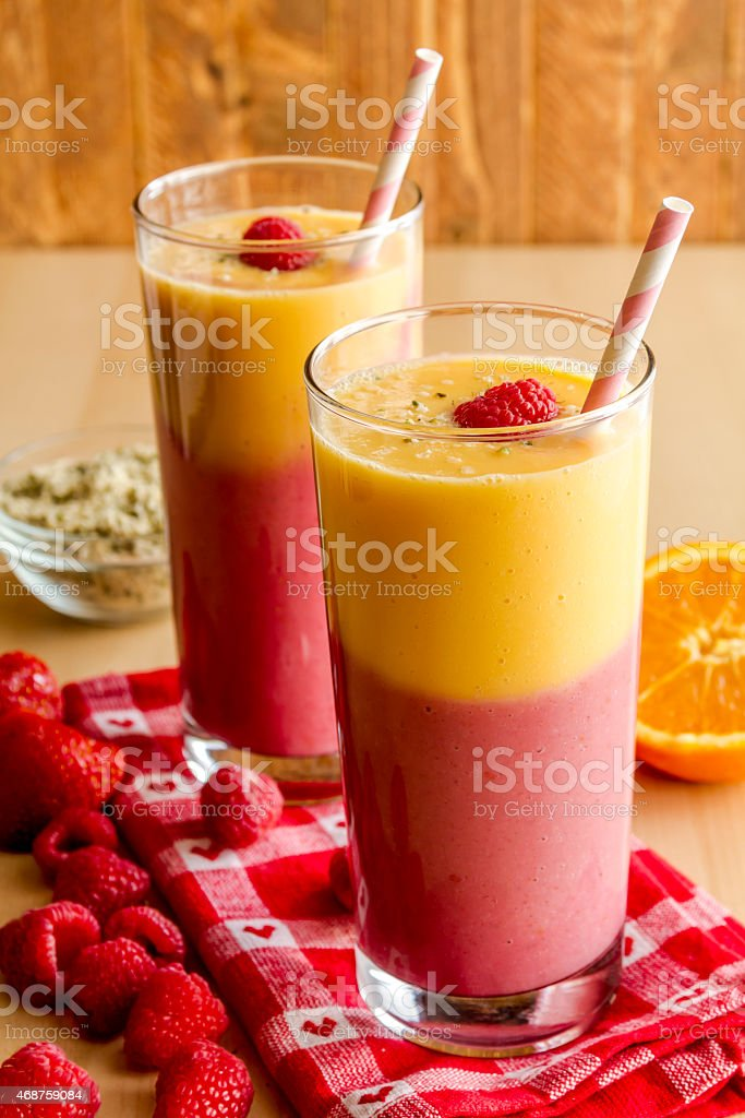Mango Orange Raspberry Strawberry Smoothies stock photo