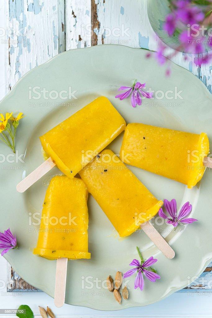 mango popsicles stock photo
