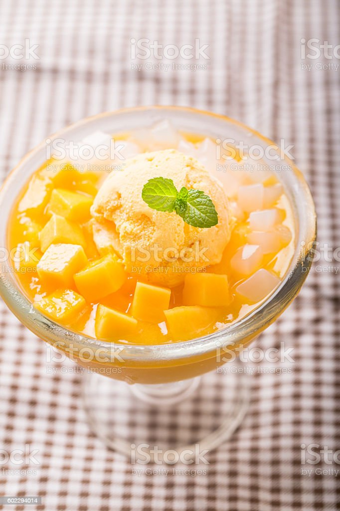 mango slices with ice cream and coconuts stock photo
