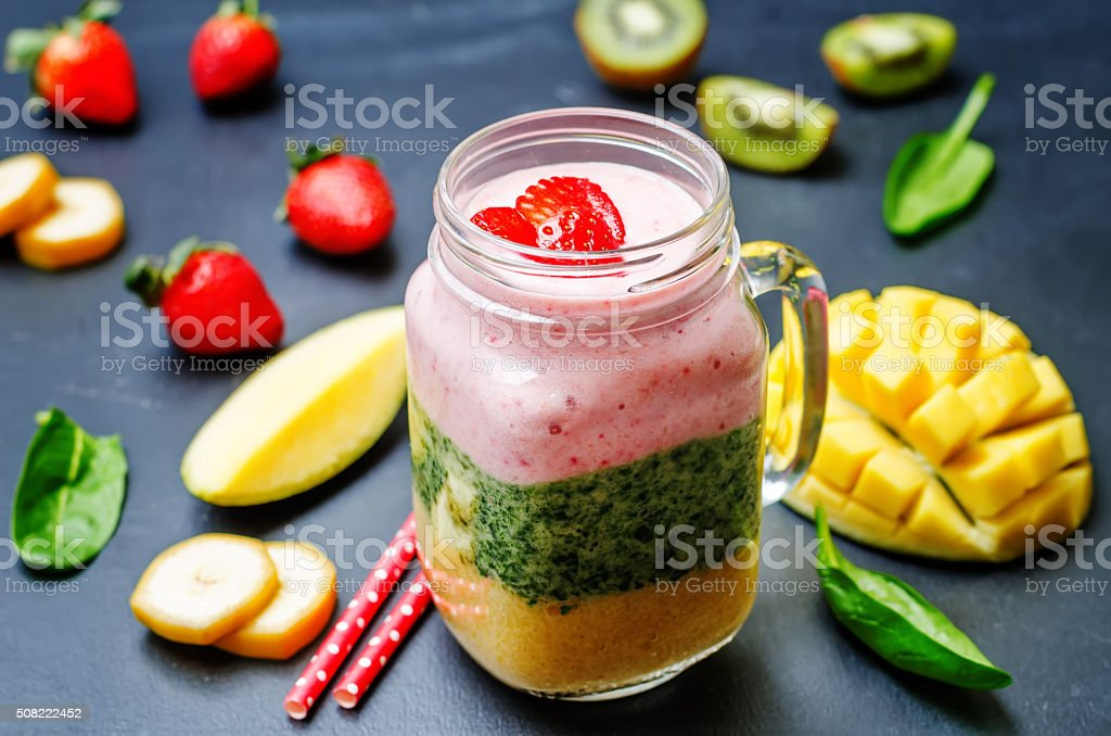 Mango Spinach kiwi strawberry banana smoothie stock photo