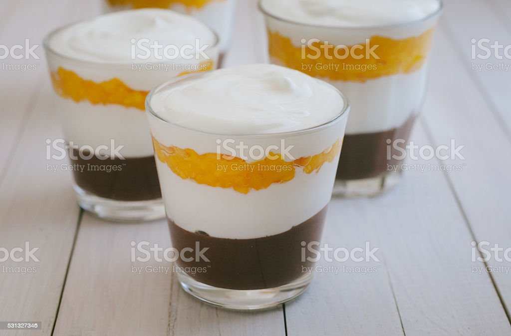 Mango trifles in glasses stock photo