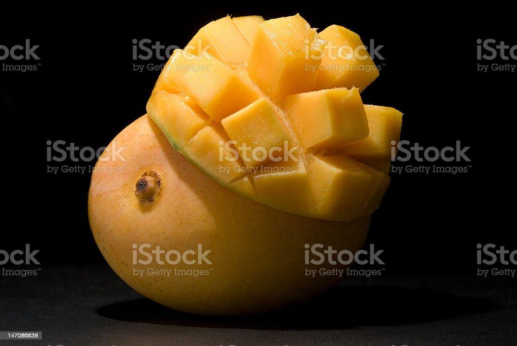 Mango under spotlight royalty-free stock photo