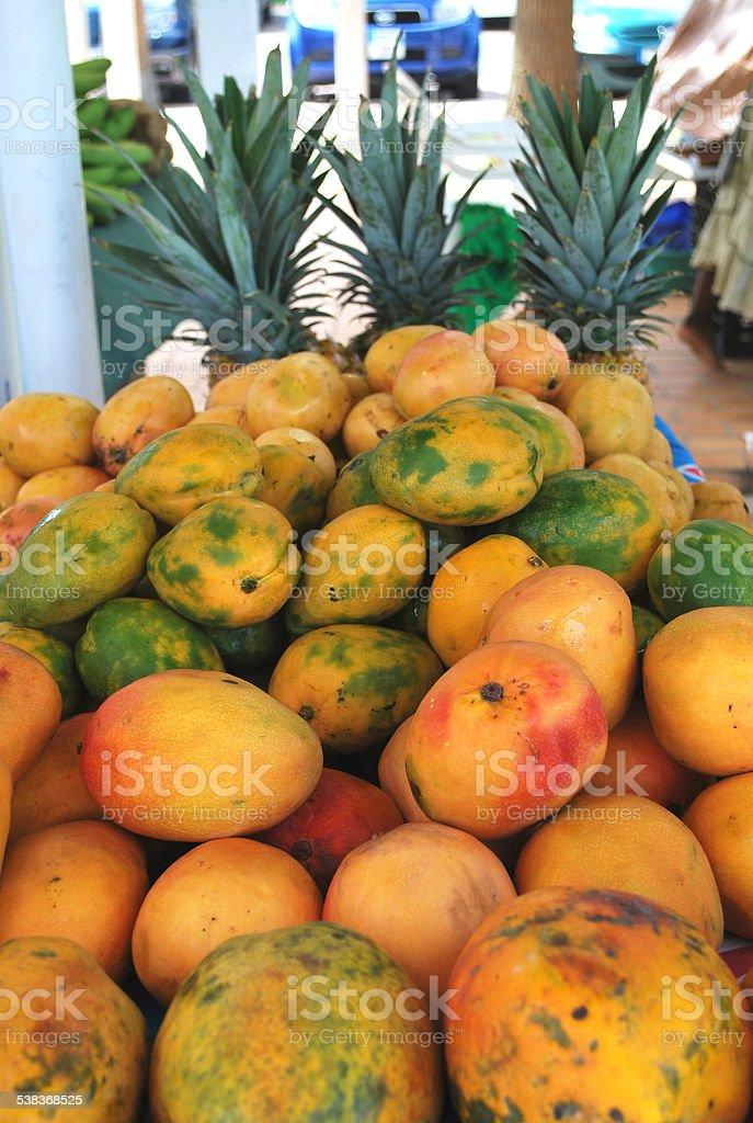 Mangos and Pineapples in Caribbean Market. stock photo