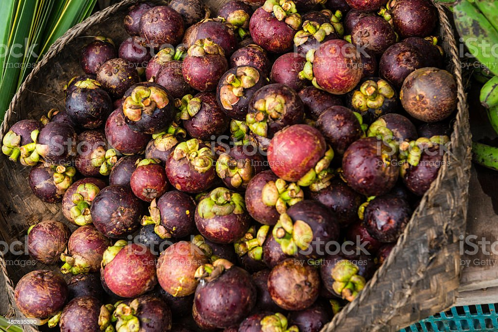 Mangosteen Tropical Fruit For Sale at Traditional Street Market Bali stock photo