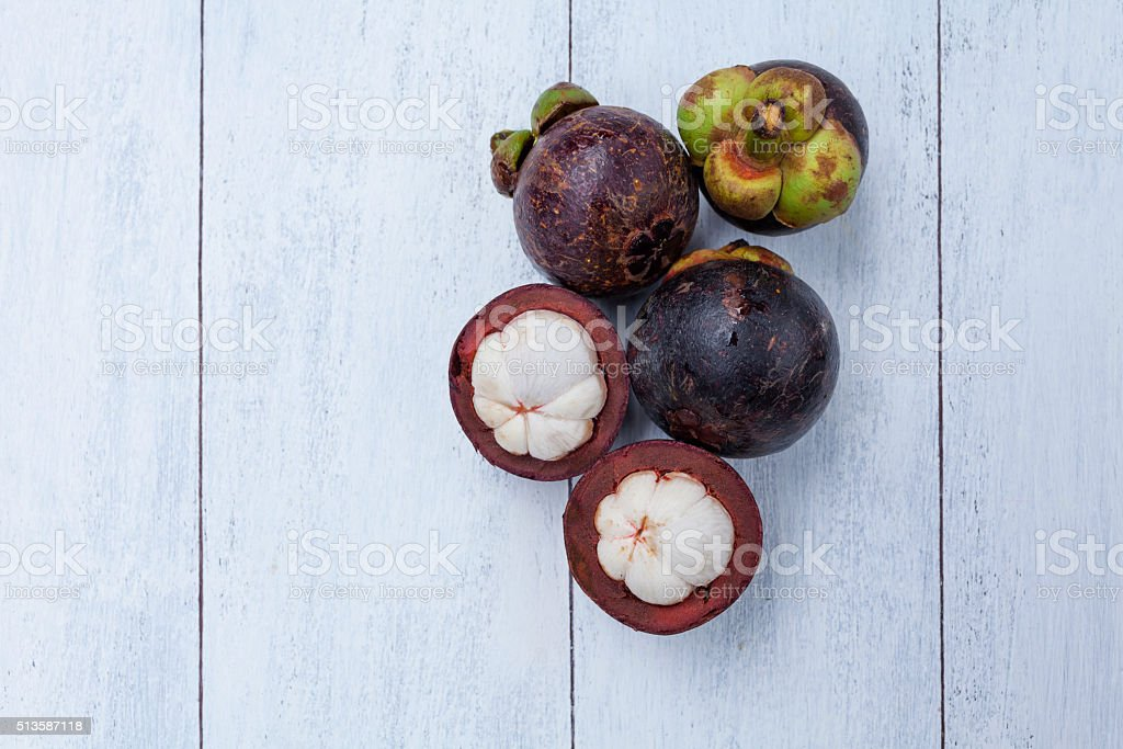 Mangosteen with space on wood background stock photo