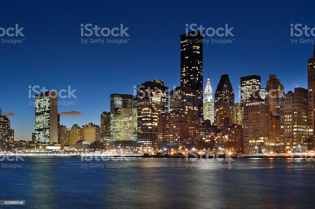 Manhattah skyline at night. stock photo