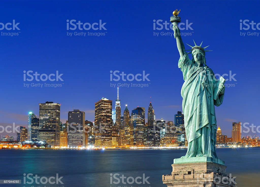 Manhattan at night and Statue of Liberty. stock photo