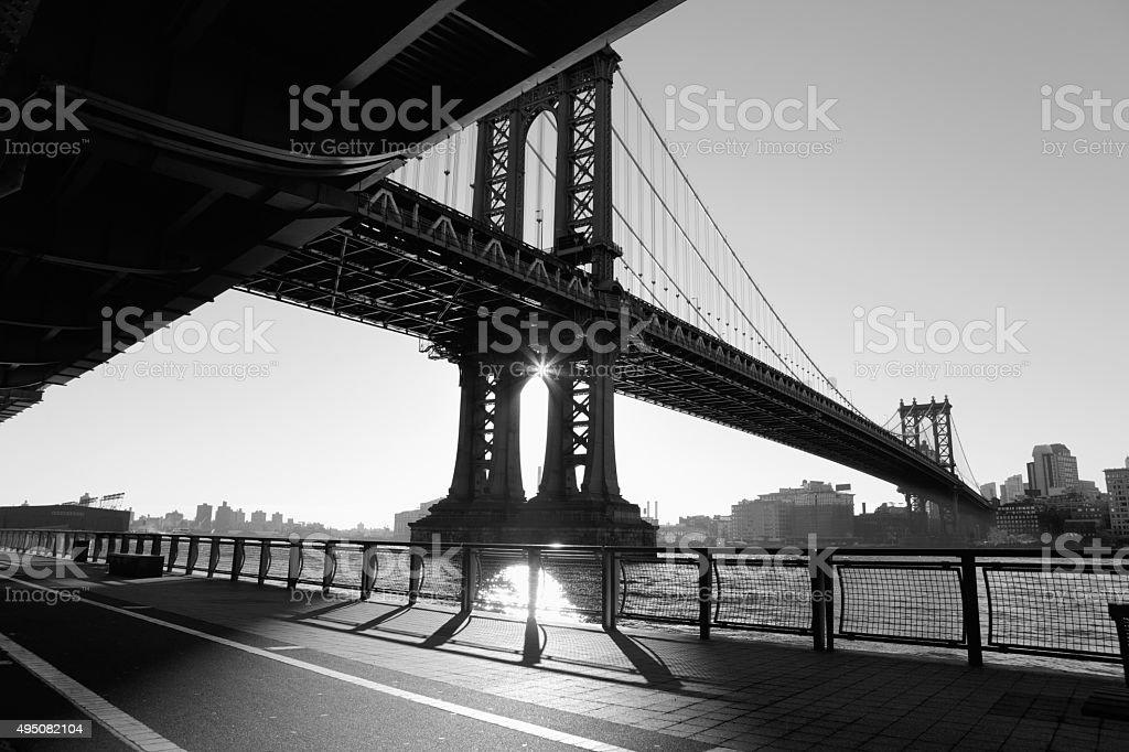 Manhattan Bridge and East River sunrise NYC deep shadows stock photo