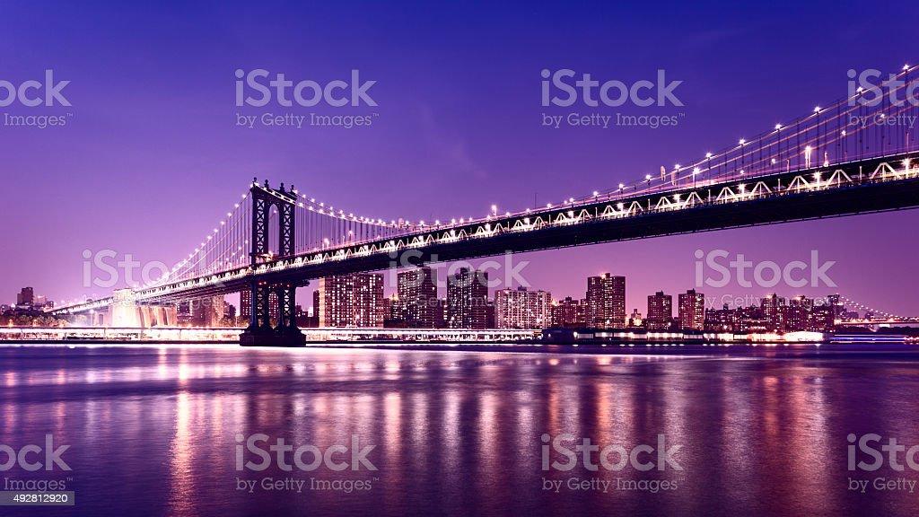 Manhattan Bridge and Manhattan skyline At Night, New York City stock photo