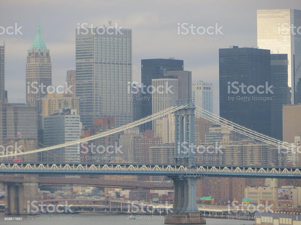 Manhattan Bridge and  Manhattan skyline look grat on Gray day stock photo