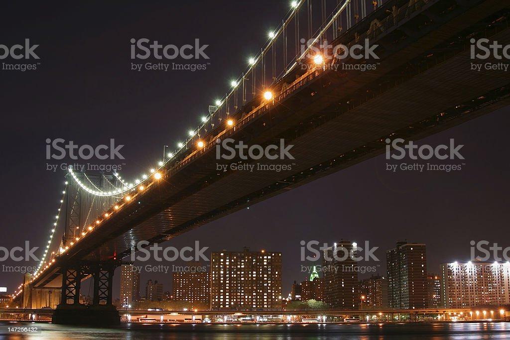 Manhattan Bridge and skyline At Night royalty-free stock photo