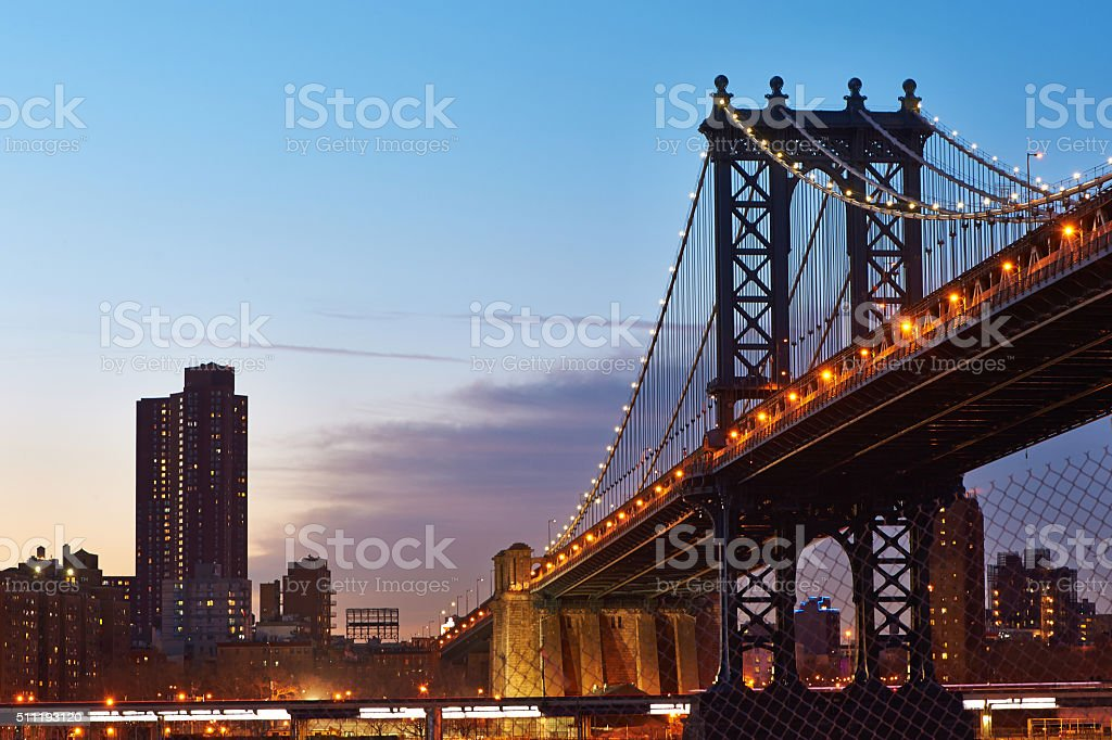 Manhattan Bridge and skyline silhouette view from Brooklyn at sunset stock photo