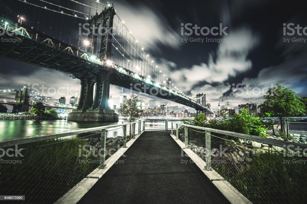 manhattan bridge at night from dumbo stock photo