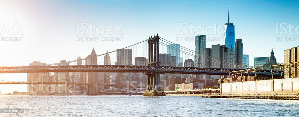 Manhattan bridge at sunset with Manhattan and Wall street stock photo