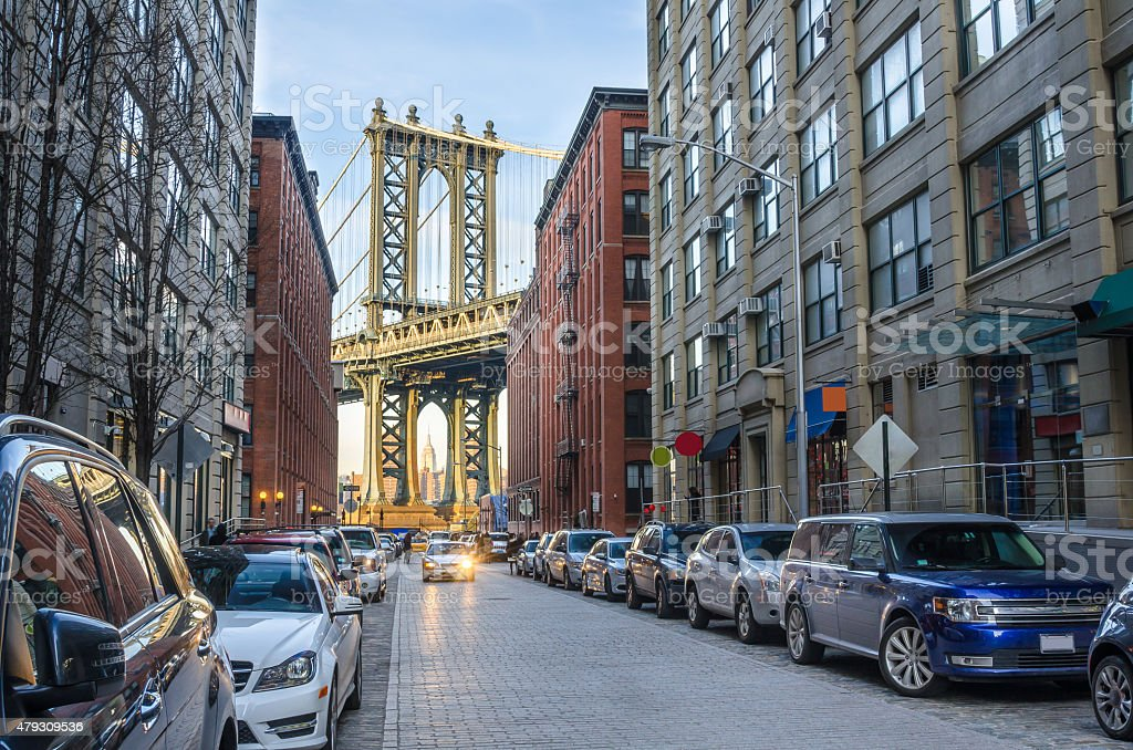 Manhattan Bridge between Renovated Warehouses stock photo